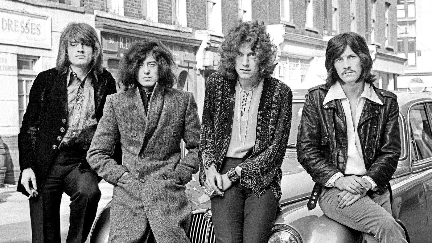 UNITED KINGDOM - DECEMBER 01:  Photo of LED ZEPPELIN; L-R: John Paul Jones, Jimmy Page, Robert Plant, John Bonham - posed, group shot, sitting on car bonnet - first photo session with WEA Records in London in December 1968. (Photo by Dick Barnatt/Redferns)