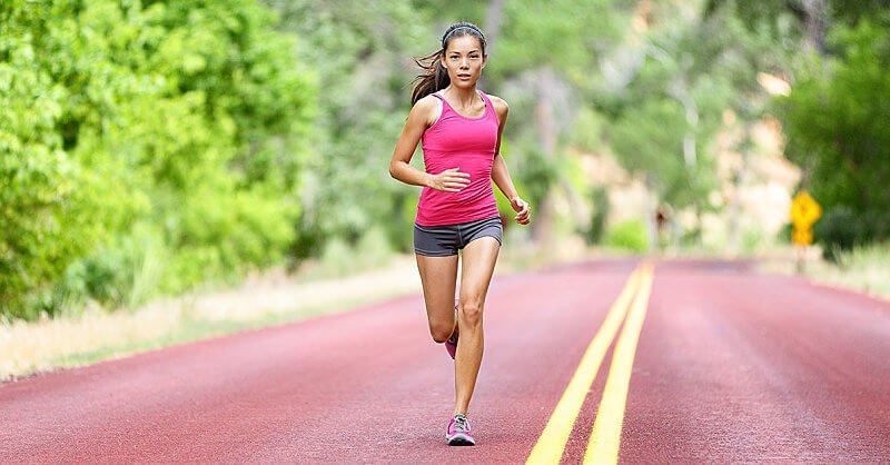 1200_woman-running-on-road